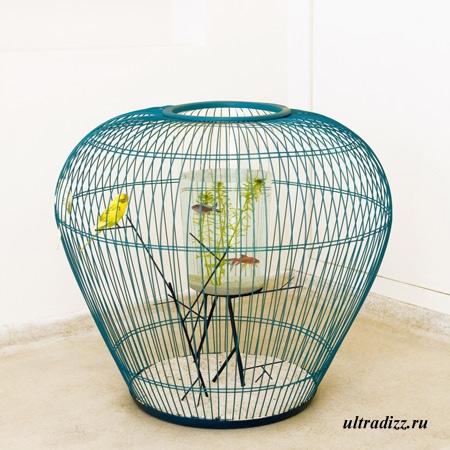 птичья клетка с аквариумом