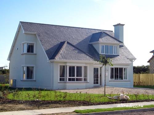 загородный каркасный коттедж с угловыми окнами