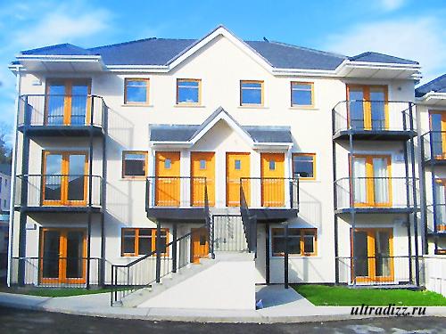 трехэтажный каркасный дом с балконами