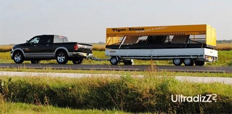 транспортировка дорожного укладчика