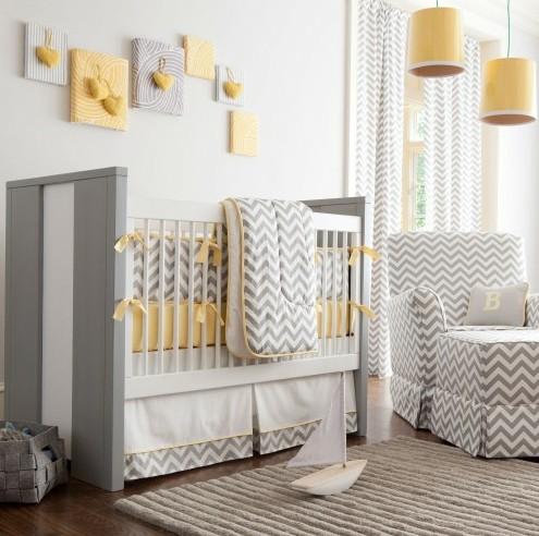 красивая серо-желтая комната для новорожденного
