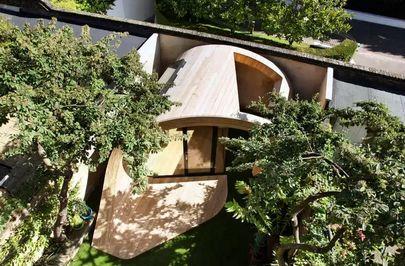 садовый павильон с деревянной обшивкой