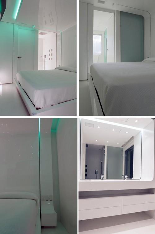белый интерьер спальни с интегрированной ванной