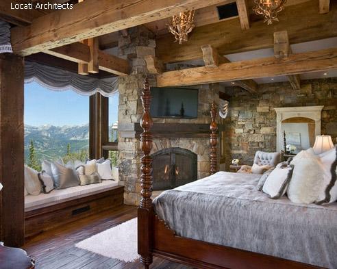 спальня в стиле рустик с камином и современным телевизором