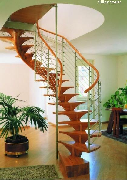 роскошная витая деревянная лестница на скульптурном косоуре